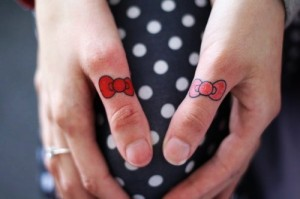 spotted hello kitty tattoo