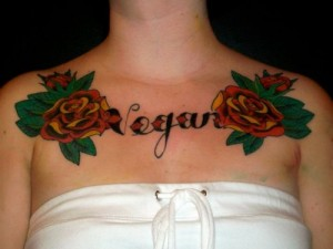 Chest rose name tattoo