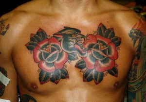 Panther rose chest tattoo