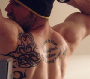 Upper back quotes tribal tattoo