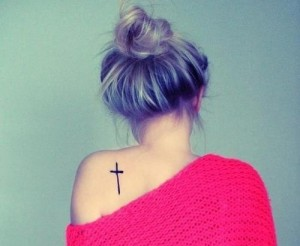 Adorable cross tattoo on the back
