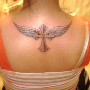 Cross and wings tattoo idea on back