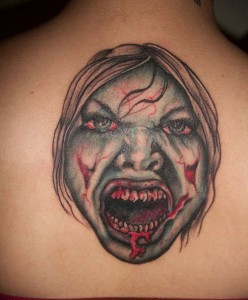 Scary zombie face tattoo design on back