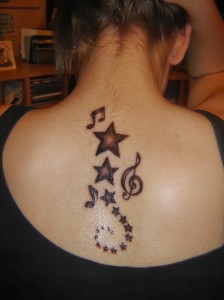 Star and music note tattoo design