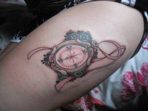Colourful compass tattoo design on thighs