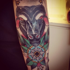Composed face of a bull tattoo design