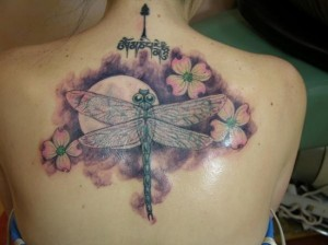 Flower and dragonfly tattoo design