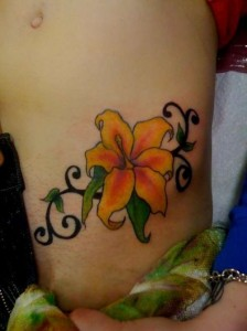 Bright and sexy flower hip tattoo design