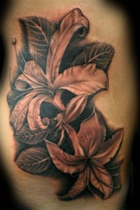 Exotic black and grey lily tattoo