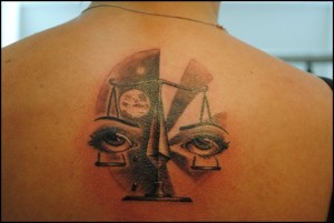 Unique Libra tattoo design with eyes on scales