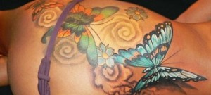 3D butterfly tattoo on hip and thigh
