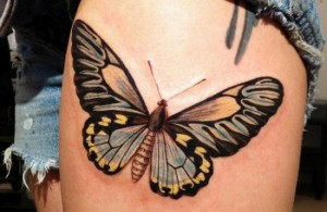 Big butterfly tattoo on thigh