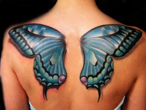 Blue butterfly wings tattoo on back and shoulders