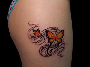 Bright yellow butterfly tattoo on thigh