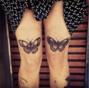 Butterfly tattoo above the knee