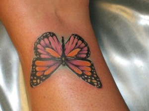 Colourful butterfly tattoo on wrist