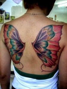 Colourful butterfly wings tattoo on back