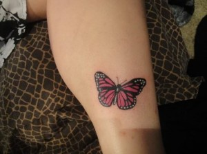Dotted butterfly tattoo on leg