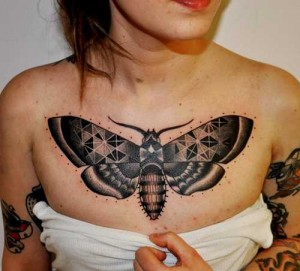 Large butterfly tattoo on chest