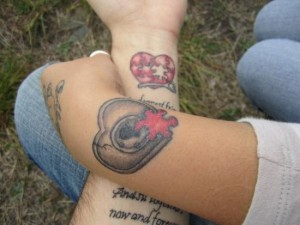 Matching heart tattoos for couples