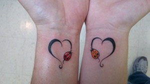 Matching hearts with beetles mother daughter tattoos