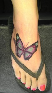 Radiant butterfly tattoo on foot