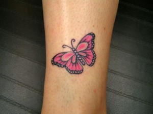 Small butterfly tattoo above the ankle