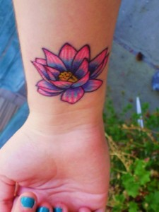 Colourful lotus flower on the wrist