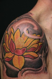Yellow and red lotus flower tattoo with black shading