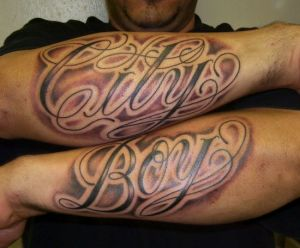 Awesome lettering arm tattoo for men