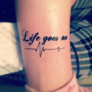 Life quote tattoo on legs