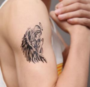 Beautiful angel wings tattoo on arms