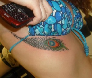 Feather breast tattoo designs