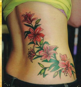 Adorable Hibiscus Lower Back Tattoo