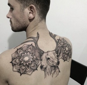 Two Faced Deer Back Tattoo