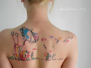 Adorable Snail Back Tattoo