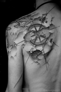 Maps And Compass Back Tattoo