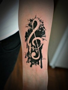 Musical Note Arm Tattoo