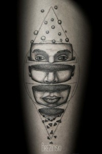 Divided Face Tattoo