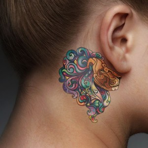 Vibrant Lion Behind The Ear Tattoo