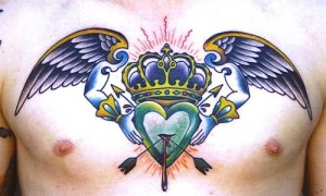 Winged Heart And Crown Chest Tattoo