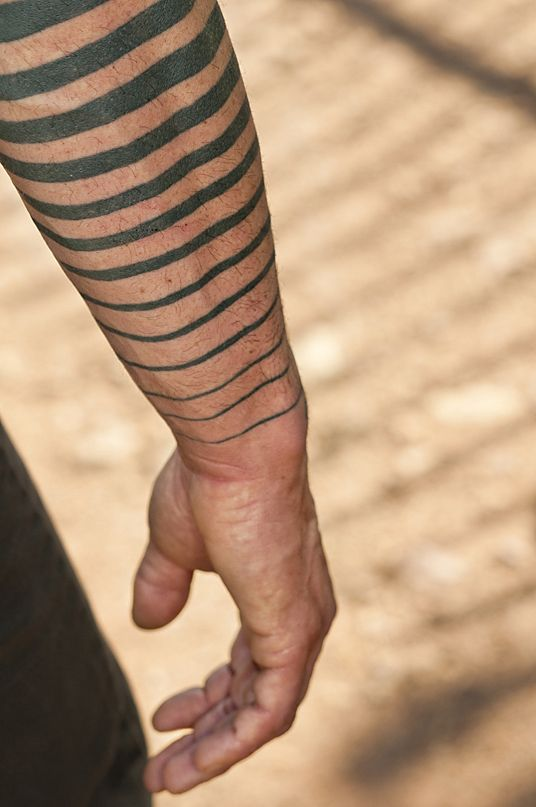 Graded Lines Wrapped Around Arm Tattoo