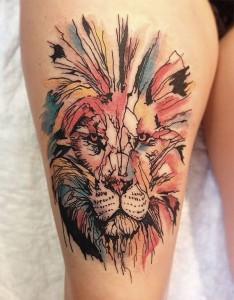 Adorable Watercolor Lion Thigh Tattoo