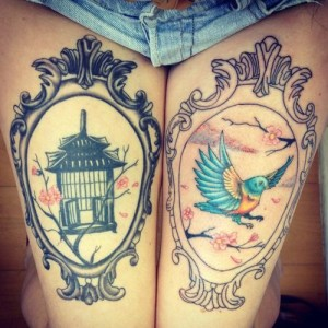 Bird And Cage Thigh Tattoos