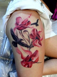Flowers And Ravens Thigh Tattoo