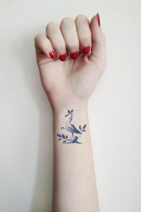 Dove With Leaves Wrist Tattoo