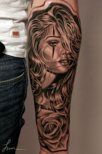 Face And Rose Forearm Tattoo
