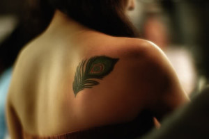 Feather Upper Back Tattoo