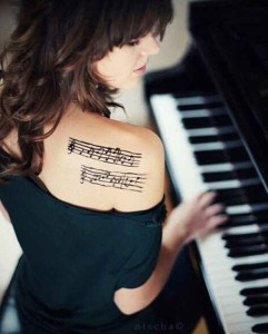 Musical Notes Upper Back Tattoo