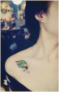 Adorable Peacock Feather Clavicle Tattoo